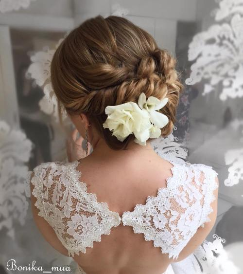 Bridal Updo With Twists And Flowers