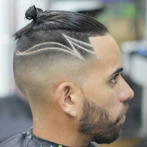 Small Man Bun And Shaved Designs