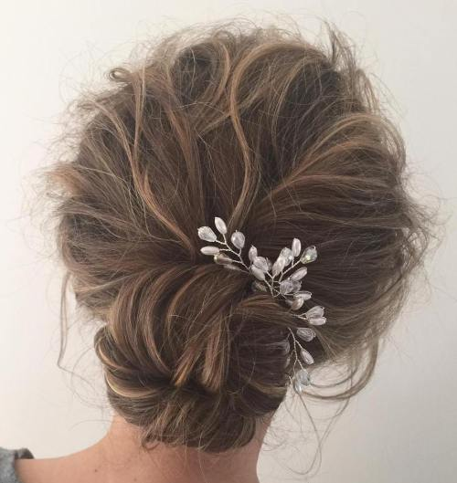 Low Tousled Updo With Sock Bun