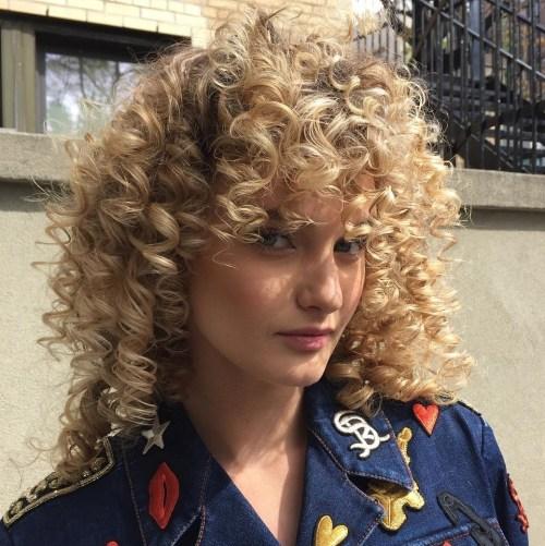 Medium Blonde Spiral Perm With Big Curls