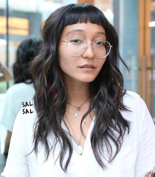Long Wavy Hairstyle With Extremely Short Bangs