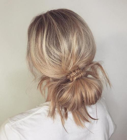 Low Knotted Bun And Fishtail Braid