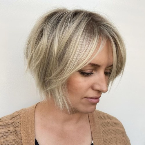 Long Side-Swept Feathered Fringe with a Short Bob