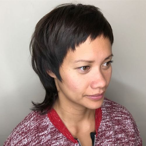 Female Mullet with Baby Bangs and Flipped Ends