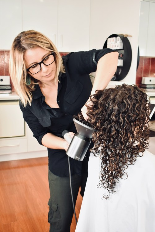 Stylist Showing How to Diffuse Curly Hair
