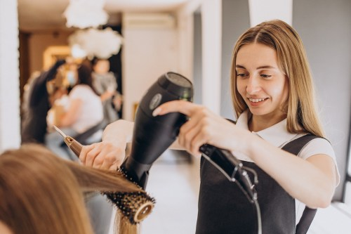 Hairdresser Blow Drying Client's Hair