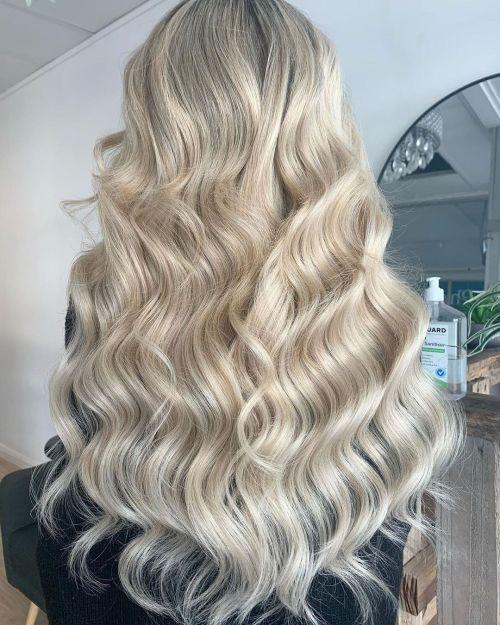 Long Layered Platinum Blonde Hairstyle