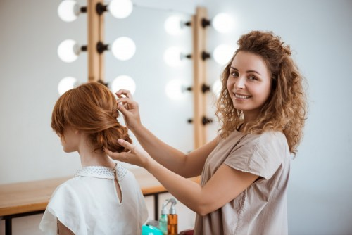 Stylist Creating a Hairstyle for Special Occasion