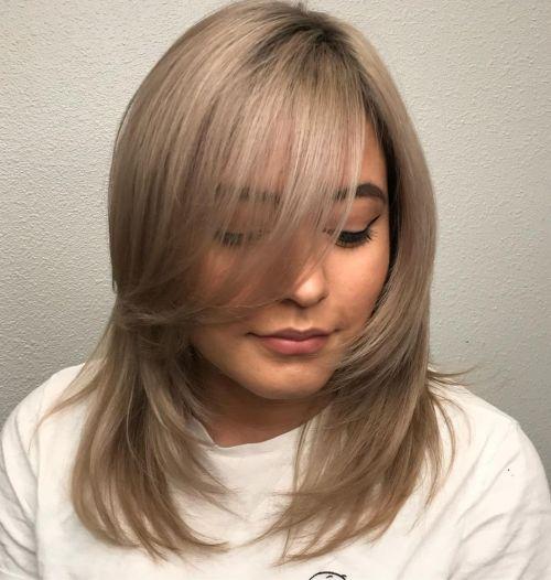 Medium Layered Hairstyle with Long Bangs
