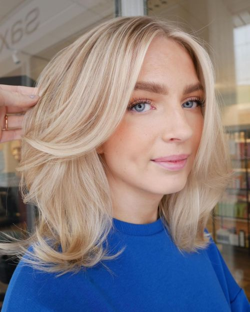 Buttery Blonde Layered Hairstyle