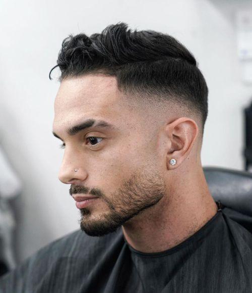 Men's Hairstyle with Pushed Back Fringe