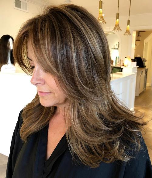 Long Feathered HAirstyle For Women Over 40