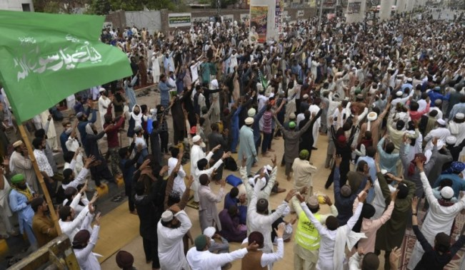 Supporters of the extremist political party Tehreek-e-Labbaik Pakistan (TLP) chant slogans as they block a street during a protest after their leader was detained following his calls for the expulsion of the French ambassador, in Lahore on April 16, 2021.