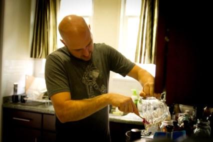 DIY Forbidden Fruit Liqueur -- Brian Finishes Adding the Honey Mixture
