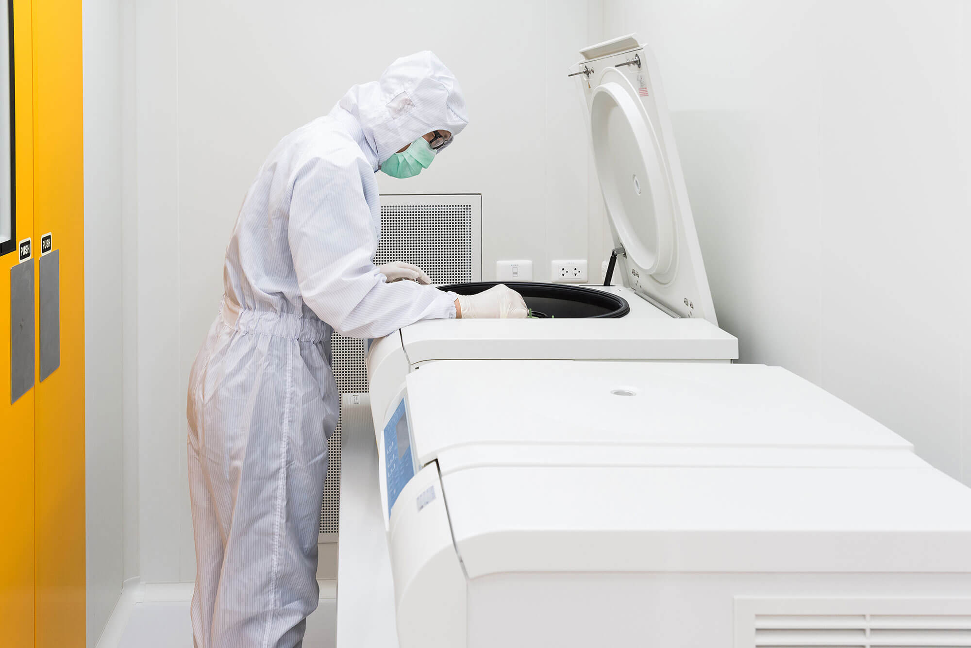 Scientist in cell manufacturing facility