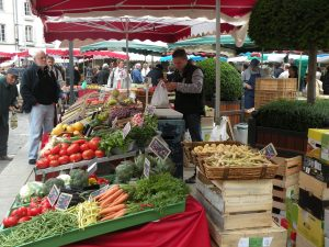 A bustling market scene in Beaune in the Burgundy region of France.