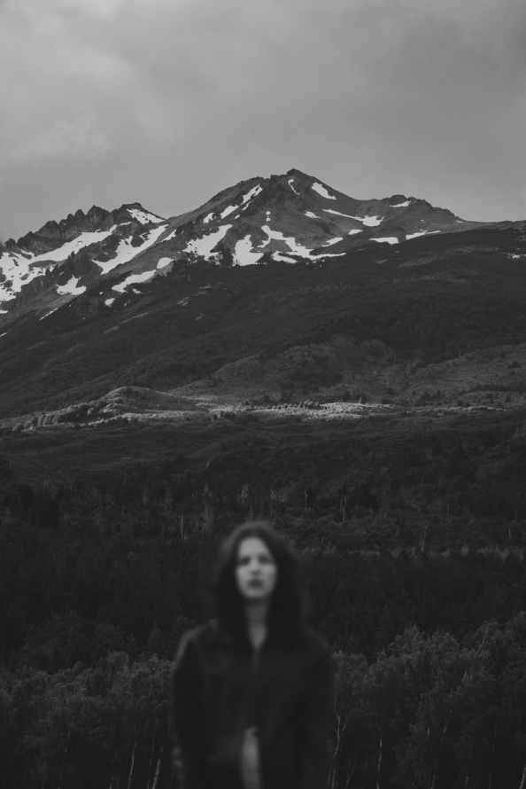 anonymous lady admiring nature in highlands under misty sky