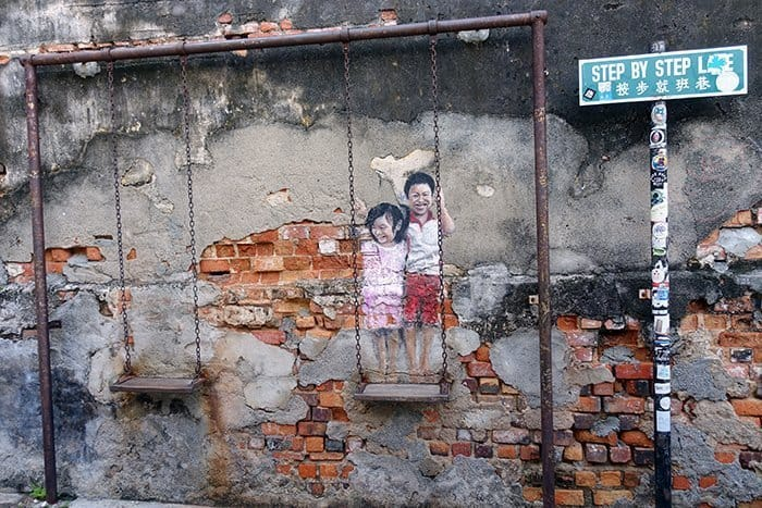 Penang Itinerary: What to do in Penang in 3 days. A Guide to this Beautiful & Historic Town in Malaysia: Children on a swing street art, murals on step by step lane, George Town