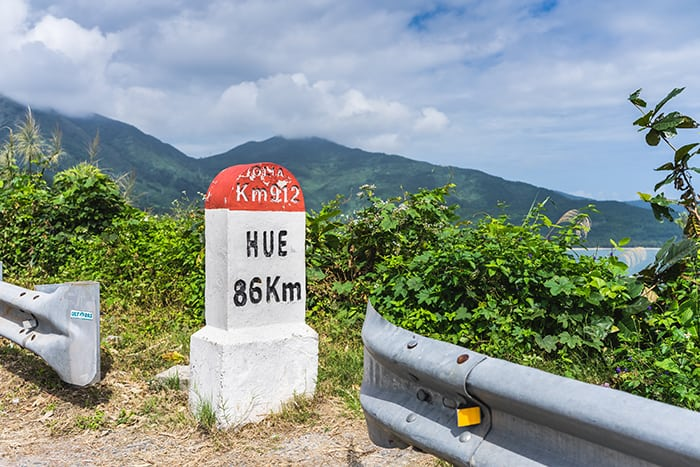 Road sign for Hue on the Hai Van Pass. 3 weeks in Vietnam, Vietnam itinerary: 3 weeks, 3 week Vietnam itinerary