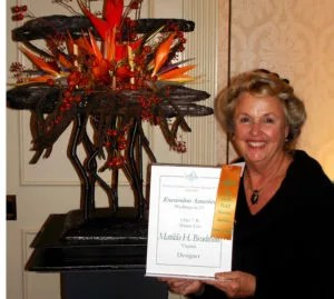 Matilda Bradshaw with her Mauna Loa themed flower arrangement and her first place award from the World Association of Flower Arrangers show in Washington, DC in October.