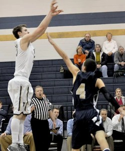 Titan senior Dylan Hodson fires from the perimeter on his way to a team-high 21 points in the win over Christiansburg.