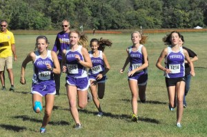 The Patrick Henry girls team warms up Saturday morning at Green Hill. The team finished 14th among the elite field of runners.
