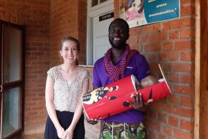 "Virginia Tech graduate student Ashley Taylor, left, models an early prototype of the ""baby pod,"" along with Domasi Rural Hospital administrator Symmington Nyondo. After receiving community feedback in Malawi, the pod was redesigned to resemble a basket."