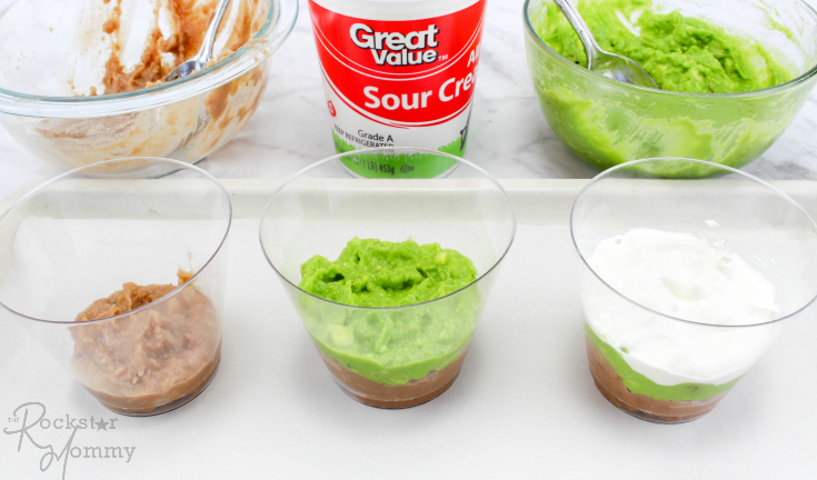 Mexican Bean Dip Cups - beans, guacamole and sour cream layered in cups