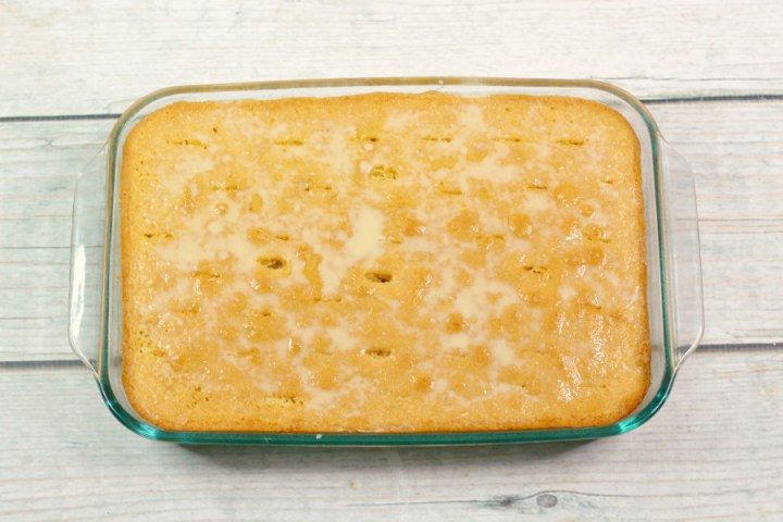 Caramel Tres Leches Cake - cooked cake with holes poked in it