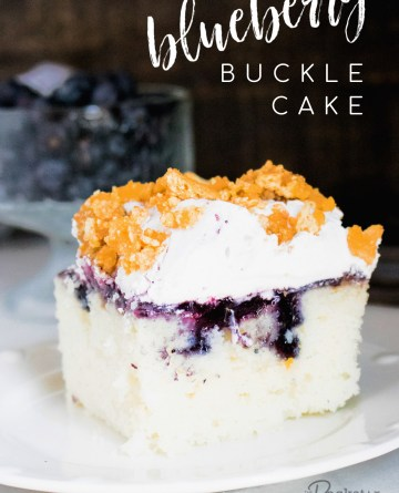 Blueberry Buckle Poke Cake Recipe - piece of cake on a white plate