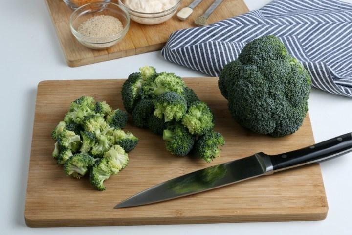 cut up broccoli on a cutting board