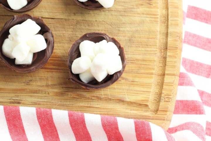 mini marshmallows being added to chocolate shell