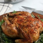 cooked chicken on a bed of greens