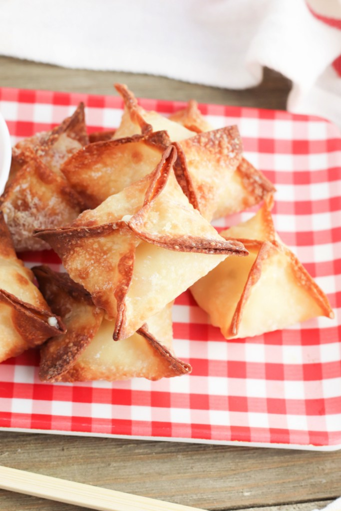 air fryer crab rangoons stacked on a plate