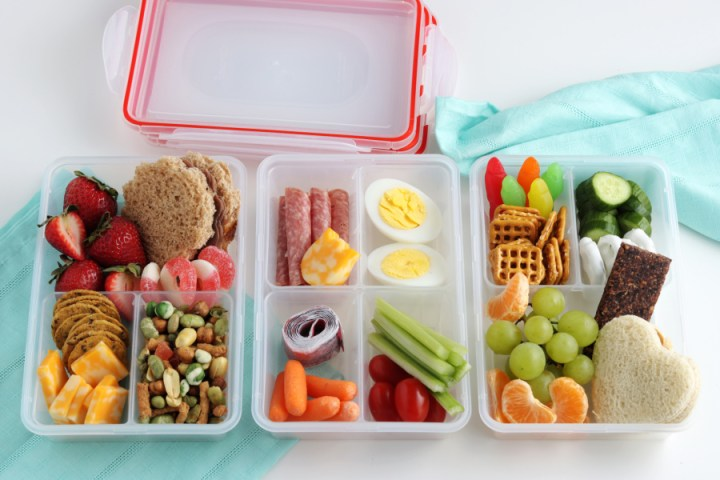 3 lunchboxes filled with food