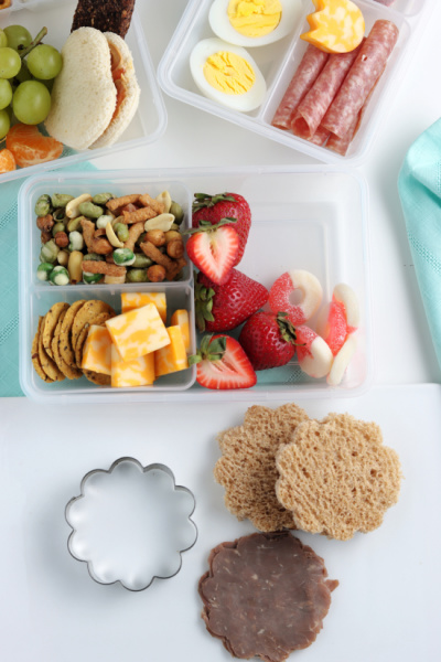 lunchbox with food being added in