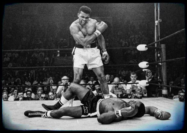 """But here was Clay on our TV, blustering, making horrible threatening faces, shaking his fists at the camera, calling Liston a """"big ugly bear"""" and predicting his demise at his own hands in unparalleled bombast. AP Photo/John Rooney"""
