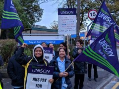 Low paid hospital workers win right to  full NHS pay rates