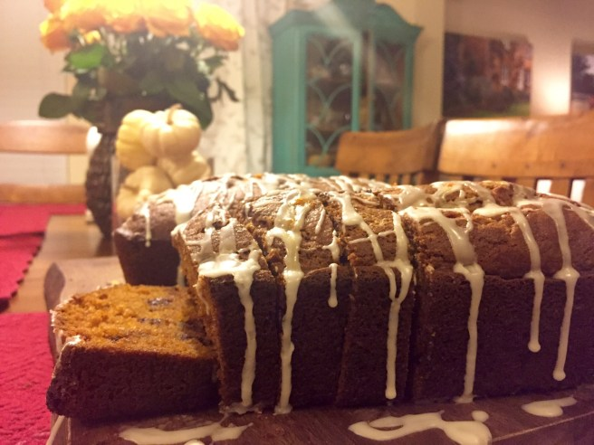 """1) Preheat the oven to 350°F. Lightly grease two 8 1/2"""" x 4 1/2"""" loaf pans (if you're making the plain version of the bread); two 9"""" x 5"""" loaf pans (if you're adding chocolate chips and nuts); or one of each, if you're making one plain loaf, and one loaf with chips and nuts. 2) In a large bowl, beat together the oil, sugar, eggs, pumpkin, and water. 3) Add the flour, baking powder, baking soda, salt, nutmeg, and vanilla, stirring to combine. 4) Mix in the chips and nuts, if you're using them. To make one loaf with chips/nuts, one loaf without, divide the batter in half. Leave one half plain, and add 3/4 cup chips and 1/2 cup nuts to the other half. 5) Spoon the batter into the prepared pans. Sprinkle the tops of the loaves with coarse sparkling sugar, if desired. 6) Bake the bread for 60 to 80 minutes, or until a cake tester or toothpick inserted in the center of the loaf comes out clean; and that same tester inserted about 1/2"""" into the top of the loaf doesn't encounter any totally unbaked batter. 7) Remove the bread from the oven, and cool it on a rack. When it's completely cool, wrap it well in plastic wrap, and store it overnight before serving."""