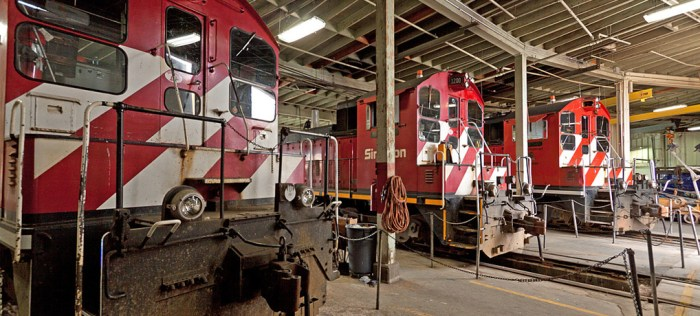 A roundhouse scene: The Simpson lokies don't get out much these days except for a bit of switching in the mornings. The 900 is in the near stall, then the 1200 and 1201 while the 1202 reposes in a stall on the west side of the building.  Photo by Joel Hawthorn.