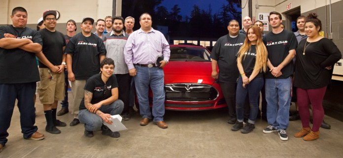 Members of the F.A.S.T. Club and representatives of Tesla Motors pose for a photo during Tesla's visit on campus. Thursday May 29, 2014. Photo: Mohammad Djauhari
