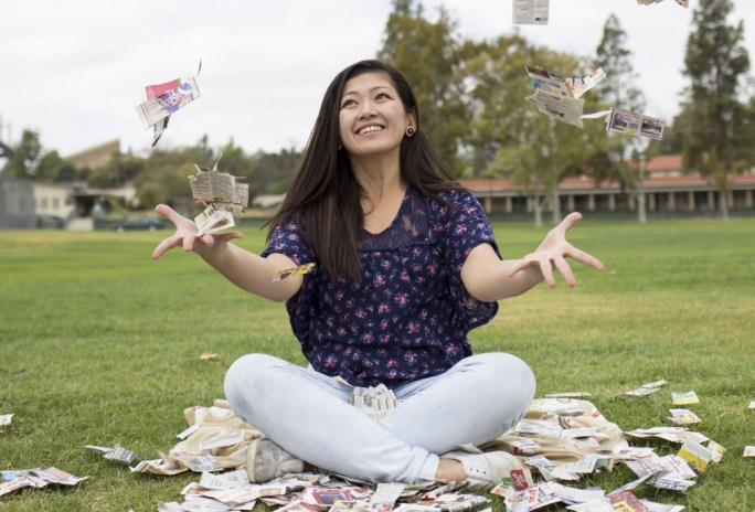 Extreme couponist, mother and nurse, Rea Tiu, plays with coupons by the soft ball field of Pierce College in Woodland Hills, Calif., Friday, Sept. 19, 2014. Photo: Nicolas Heredia