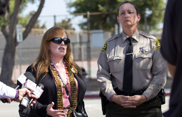 Pierce College President Kathleen Burke (left) and Captain Cherryl Newman-Tarwater (right) of the Los Angeles County Sheriffs Department hold a press conference by the Sheriffs station on the Pierce College campus in Woodland Hills, Calif., on Oct. 16, 2014. Pierce College was evacuated due to a threat posted on social media directed toward the school. A male 26-year-old former student was arrested off campus but was not found with any weapons on him, although he does have weapons registered in his name. Photo: Nicolas Heredia