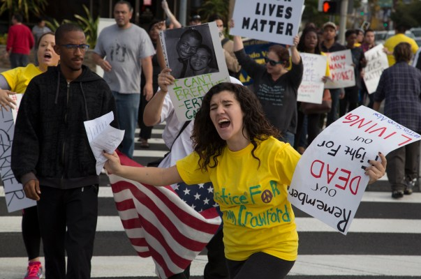 Krista Fonseca, biology major at Pierce College, leads the San Fernando Valley Walks for Justice protest to raise awareness of police brutality and racial profiling. The protesters walked on Ventura Blvd. from Sherman Oaks to Van Nuys on Dec. 8, 2014.