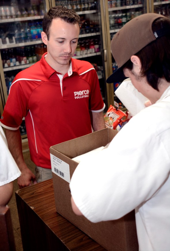 Assistant Coach Bronson Olivera of the Pierce College Men's Volleyball team picks up food for the team at Cavarettas, one of their sponsors located in Canoga Park since 1959, on March 13th, 2015.  Woodland Hills, Calif. Photo by: Scott Aaronson
