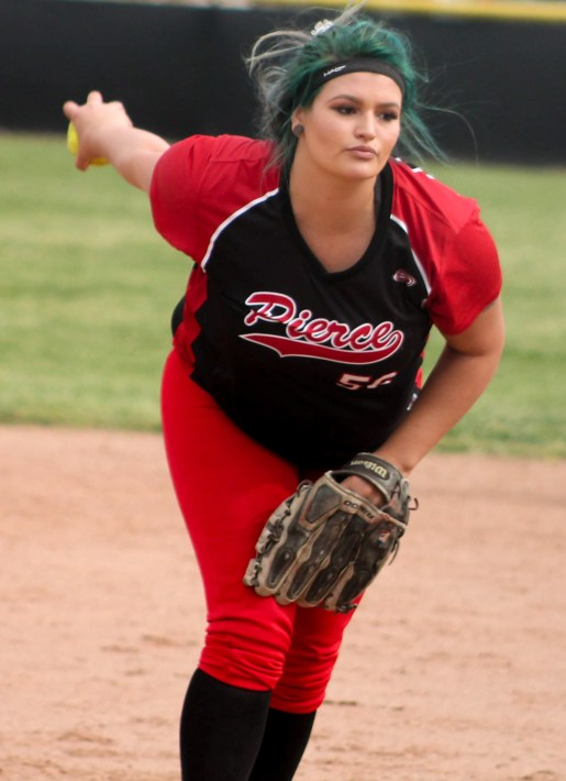 Katelyn Vogler preparing to pitch. On the Softball Field at Pierce College Woodland Hills Calif. Monday, March 17, 2015. Photo By Tim Daoud, 2015. Photo By Tim Daoud