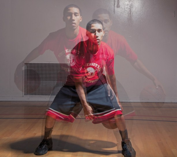 JR Williams exhibits his basketball dribbling skills inside the South Gym. Ranked 5th in assists overall with 209, Williams helped his team make the playoffs. Photo by: Mohammad Djauhari