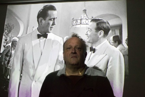 """Ken Windrum stands in front of the projector showing """"Casablanca"""" in the VILGE 8300 at Pierce College in Woodland Hills, Calif. on Monday, Oct. 5, 2015. Windrum shows this film in his introduction to screenwriting class."""