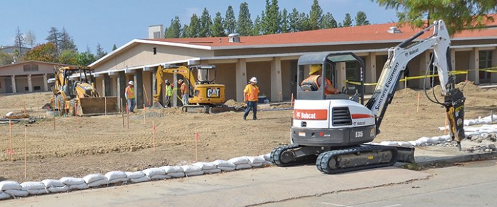 Construction workers from Balfour Beatty Construction by the district with the Measure A Bond Fund to complete construction, working on the continued construction site across from then Gymnasium on Oct. 16, 2015 at Pierce College, Woodland Hills, Calif. Photo: Christopher Mulrooney