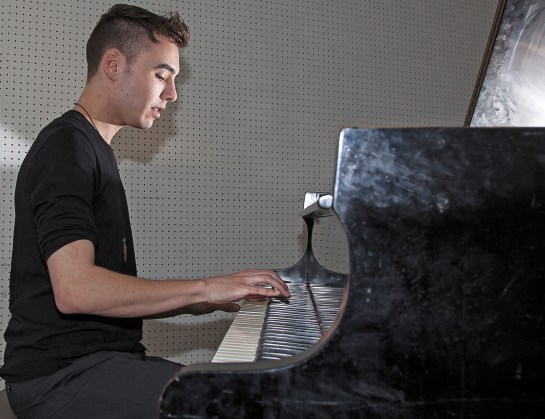 "22-year-old Evan Henzi, a ethnomusicology major, plays his original score ""Alien,"" on a piano inside one of the music rooms of the Music Center at Pierce College in Woodland Hills, Calif. on Wednesday, March 30, 2016. Photo: Mohammad Djauhari"